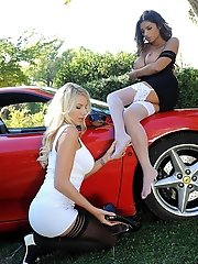 Leggy beauties rock the car!